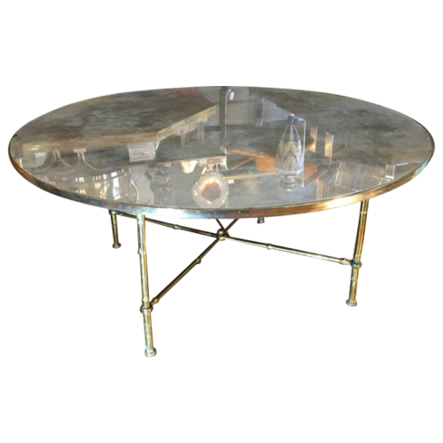 "Maison Baguès, round brass ""Bamboo"" coffee table, gilt mirror glass, circa 1940"